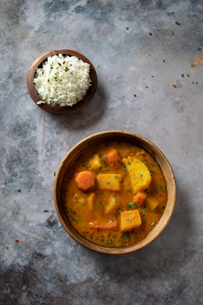 Flat lay of vegetable curry with rice by George Alexander