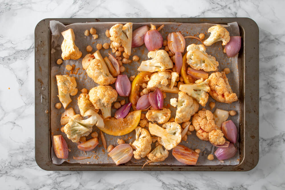 Indian Cauliflower Tray Bake - All Ingredients Mixed Together