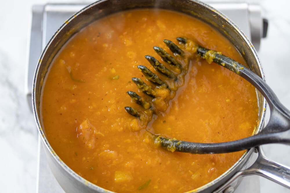 Roasted Pumpkin Curry Soup - Mashing the Pumpkin Chunks